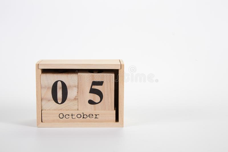 Wooden calendar October 05 on a white background. Close up stock photos