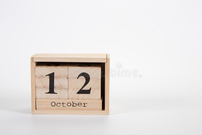 Wooden calendar October 12 on a white background. Close up stock images