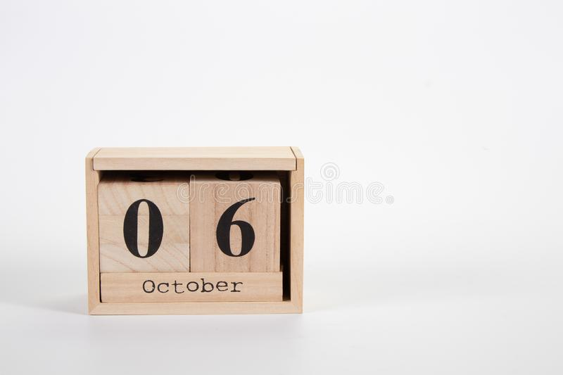 Wooden calendar October 06 on a white background. Close up royalty free stock images