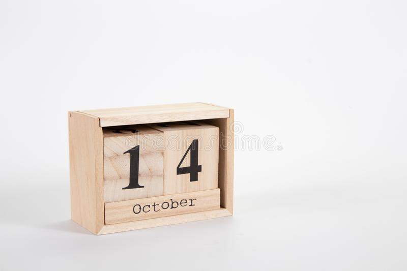 Wooden calendar October 14 on a white background. Close up stock image