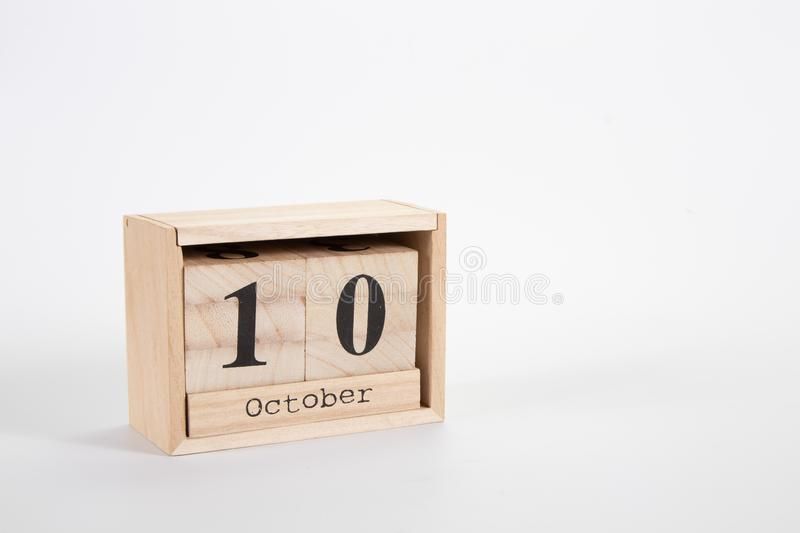 Wooden calendar October 10 on a white background. Close up royalty free stock photo