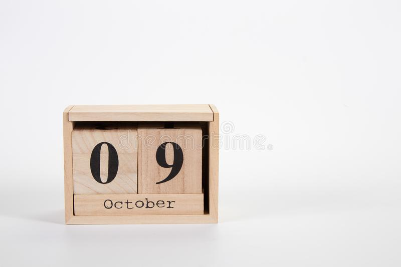 Wooden calendar October 09 on a white background. Close up stock image
