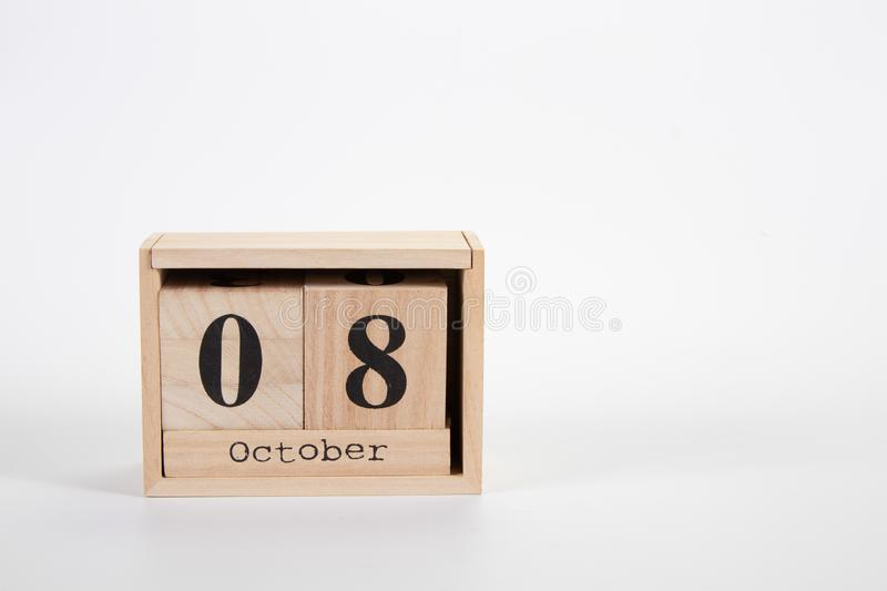 Wooden calendar October 08 on a white background. Close up stock photography