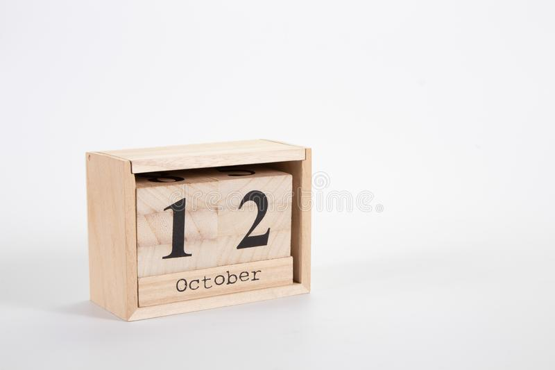 Wooden calendar October 12 on a white background. Close up royalty free stock image