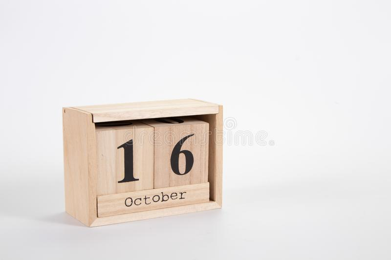 Wooden calendar October 16 on a white background. Close up stock image