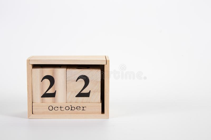 Wooden calendar October 22 on a white background. Close up stock images