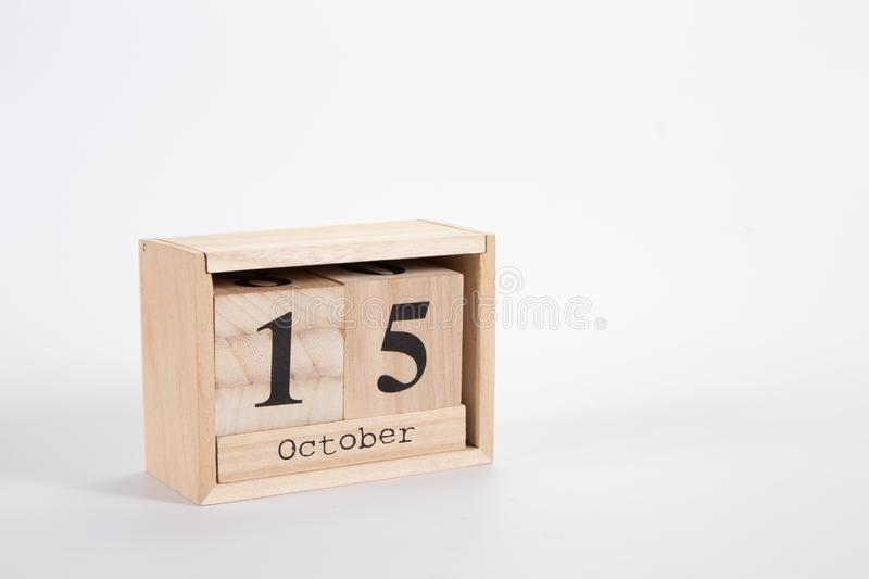 Wooden calendar October 15 on a white background. Close up royalty free stock photography