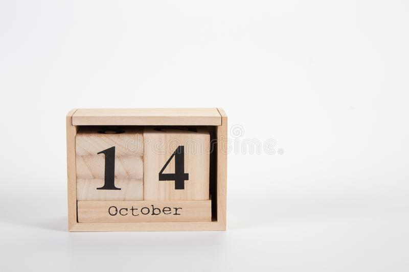 Wooden calendar October 14 on a white background. Close up royalty free stock images