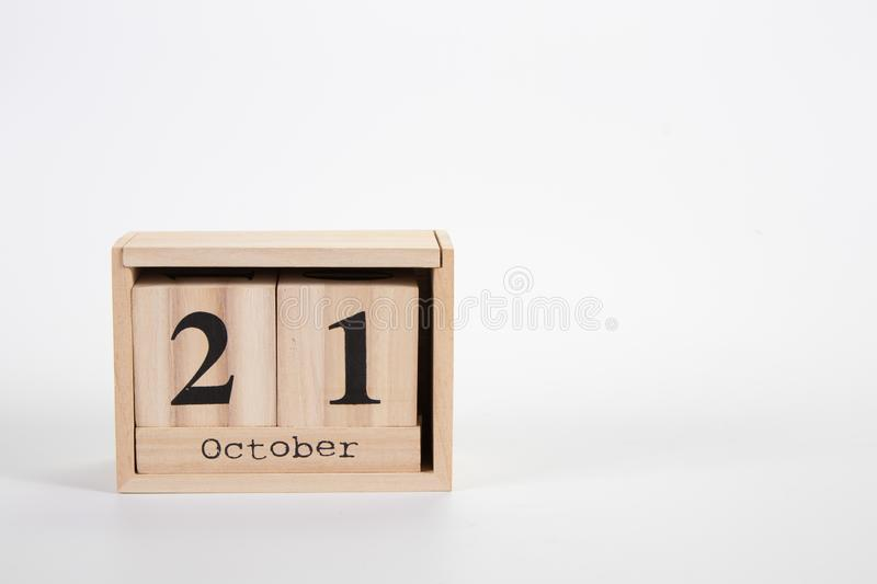 Wooden calendar October 21 on a white background. Close up royalty free stock photo