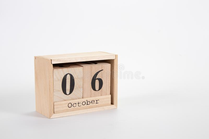 Wooden calendar October 06 on a white background. Close up stock image