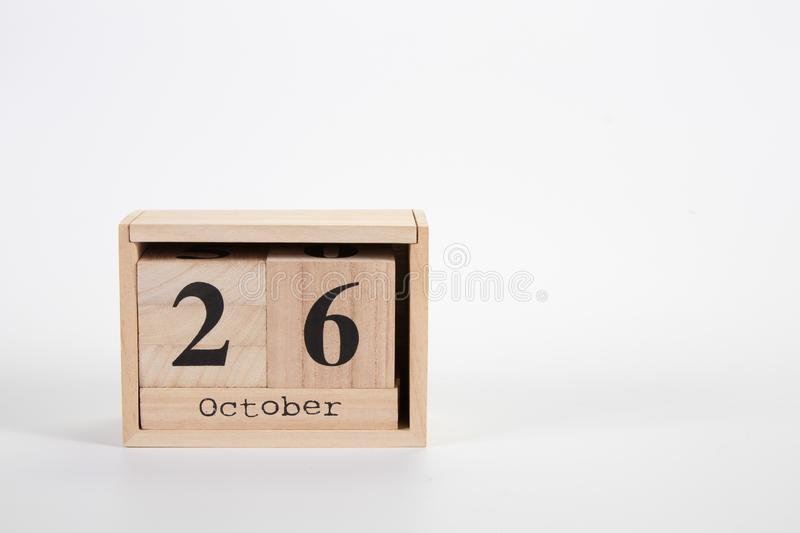 Wooden calendar October 26 on a white background. Close up stock photos