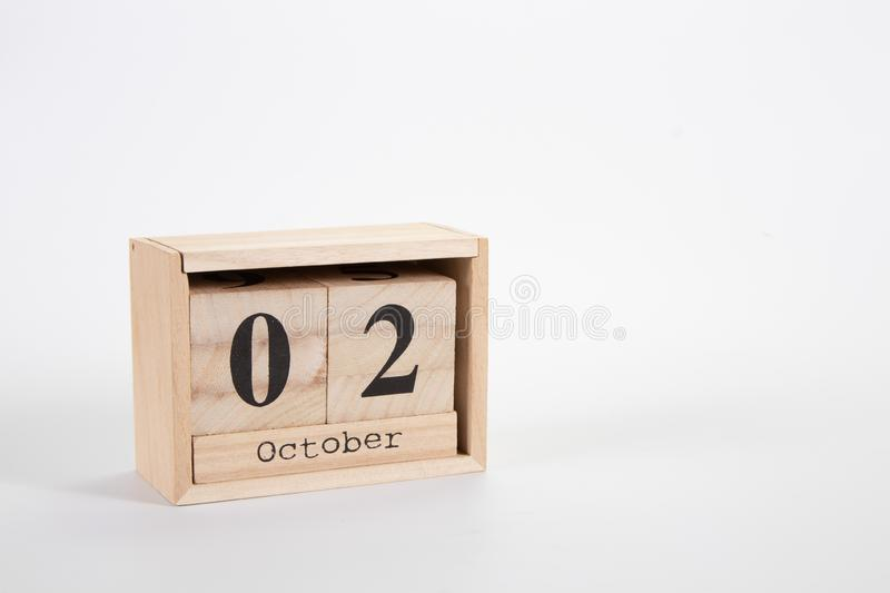Wooden calendar October 02 on a white background. Close up royalty free stock photos
