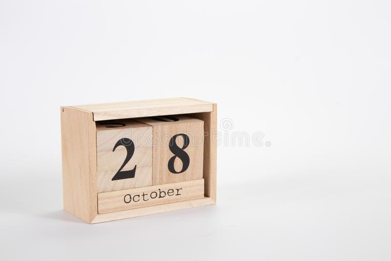 Wooden calendar October 28 on a white background. Close up royalty free stock image