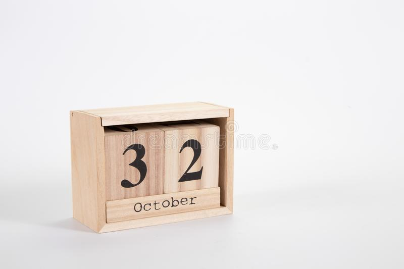 Wooden calendar October 32 on a white background. Close up royalty free stock photography