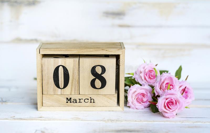Mother`s Day Greeting Card with Rose and Wooden Calendar. Wooden Calendar and Pink Rose for Mother`s Day.8th March royalty free stock photos
