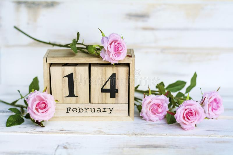 Valentine`s Greeting Card with Roses and Wooden Calendar. Wooden Calendar and Pink Roses for Valentines`s Day royalty free stock photos