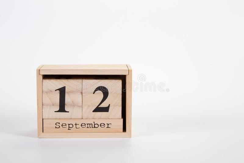 Wooden calendar September 12 on a white background. Close up stock image