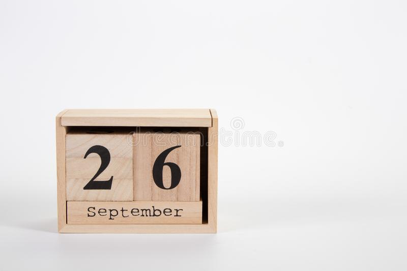 Wooden calendar September 26 on a white background. Close up stock images