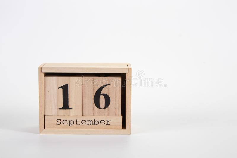 Wooden calendar September 16 on a white background. Close up stock photo