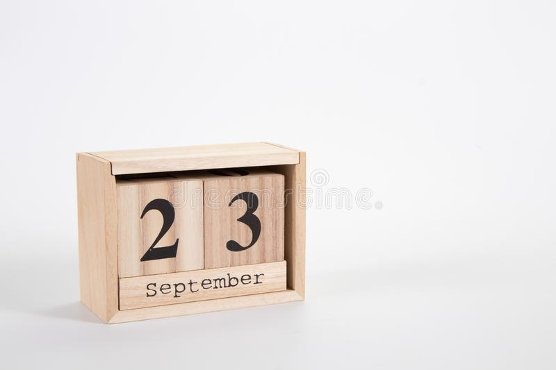 Wooden calendar September 23 on a white background. Close up stock images