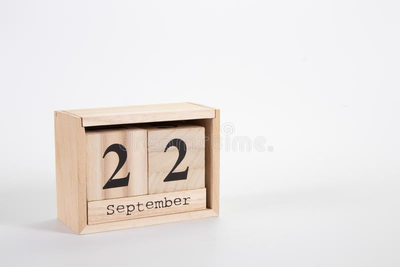 Wooden calendar September 22 on a white background. Close up stock image