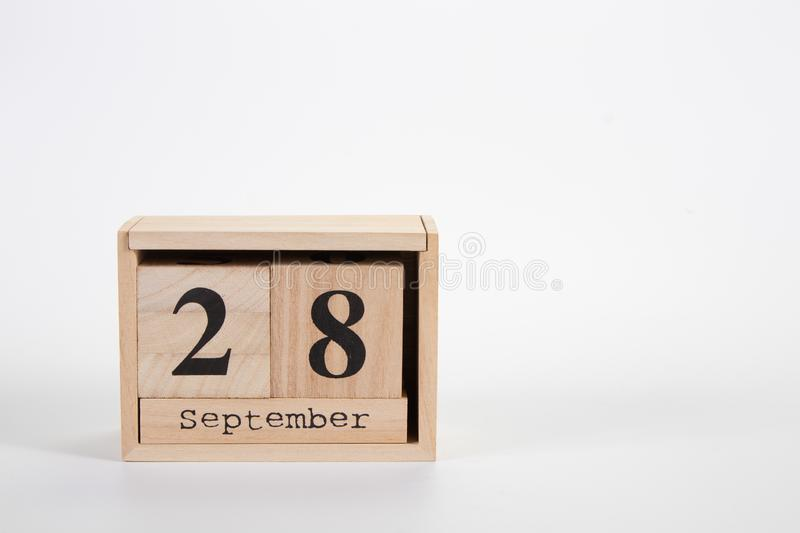 Wooden calendar September 28 on a white background. Close up royalty free stock image