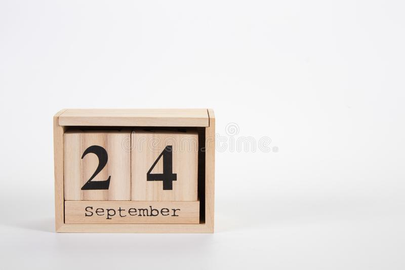 Wooden calendar September 24 on a white background. Close up royalty free stock image