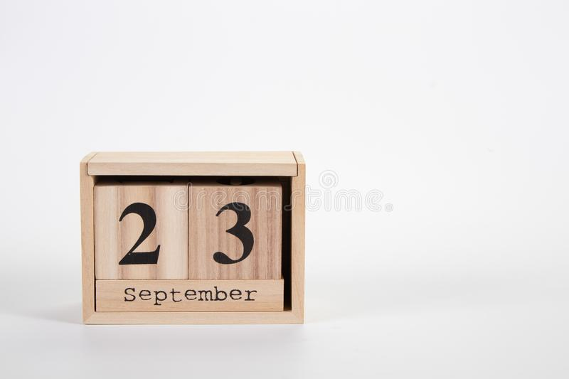 Wooden calendar September 23 on a white background. Close up royalty free stock photos