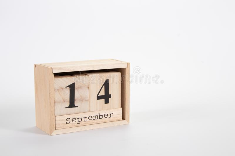 Wooden calendar September 14 on a white background. Close up stock image