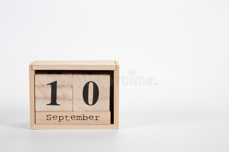 Wooden calendar September 10 on a white background. Close up royalty free stock image