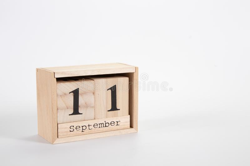 Wooden calendar September 11 on a white background. Close up stock photo