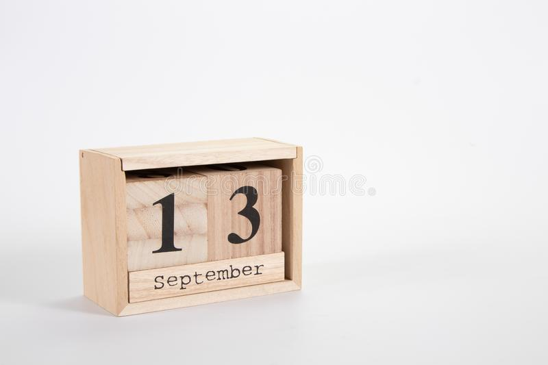 Wooden calendar September 13 on a white background. Close up stock images