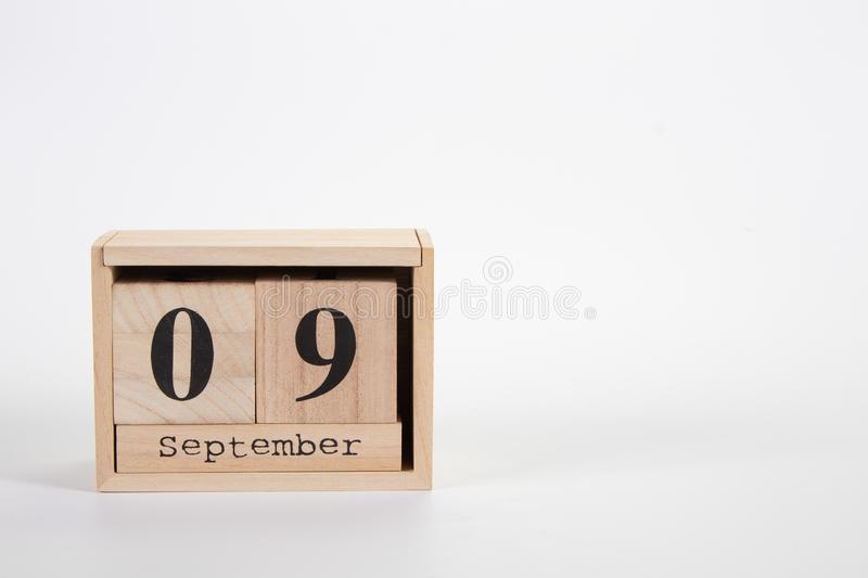 Wooden calendar September 09 on a white background. Close up royalty free stock photos