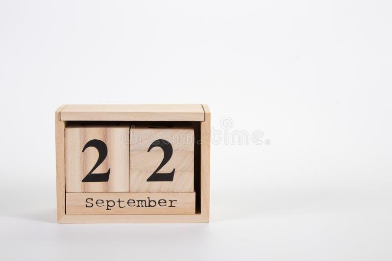 Wooden calendar September 22 on a white background. Close up stock photos