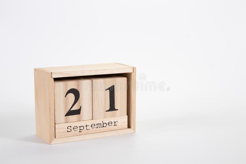 Wooden calendar September 21 on a white background. Close up stock images