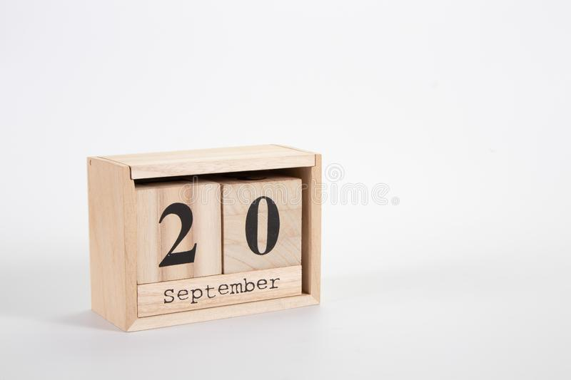 Wooden calendar September 20 on a white background. Wooden calendar September20 on a white background close up royalty free stock photography