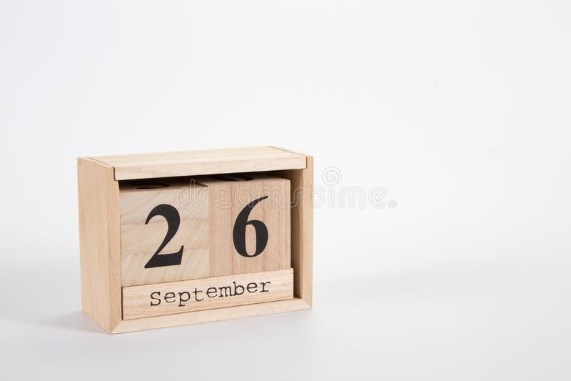 Wooden calendar September 26 on a white background. Close up stock image