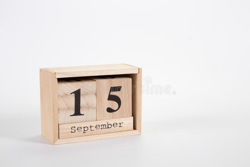 Wooden calendar September 15 on a white background. Close up stock photography