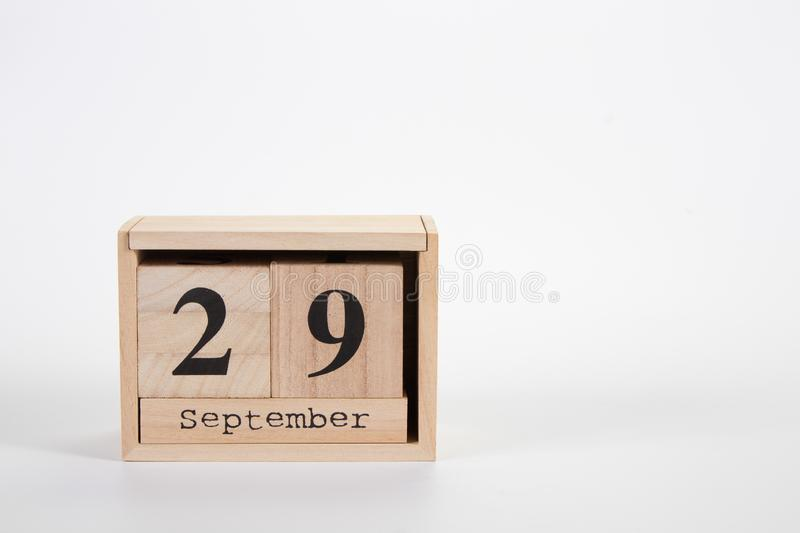 Wooden calendar September 29 on a white background. Close up stock images