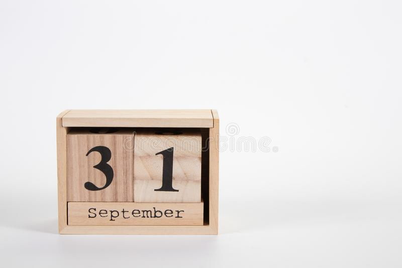 Wooden calendar September 31 on a white background. Close up royalty free stock image