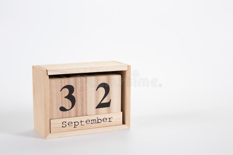 Wooden calendar September 32 on a white background. Close up royalty free stock photography