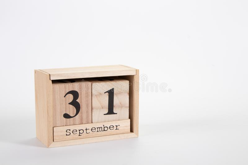 Wooden calendar September 31 on a white background. Close up royalty free stock images