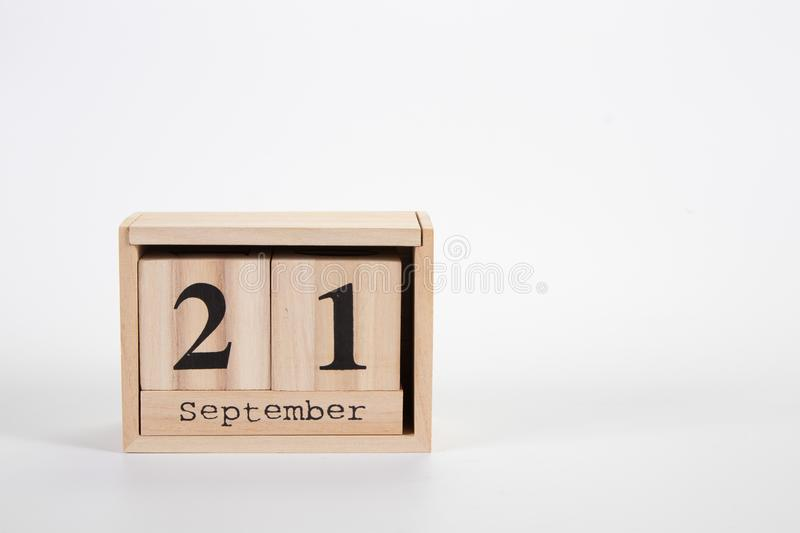 Wooden calendar September 21 on a white background. Close up royalty free stock photo