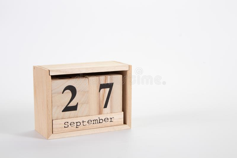 Wooden calendar September 27 on a white background. Close up royalty free stock photos