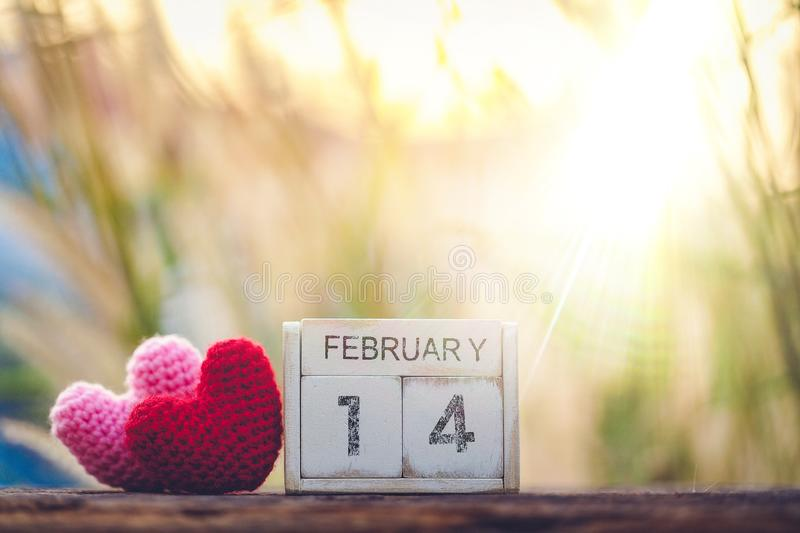 Wooden calendar show of February 14 with pink heart. Valentine`s Day, or St Valentine`s Day, is celebrated every year on 14 royalty free stock image