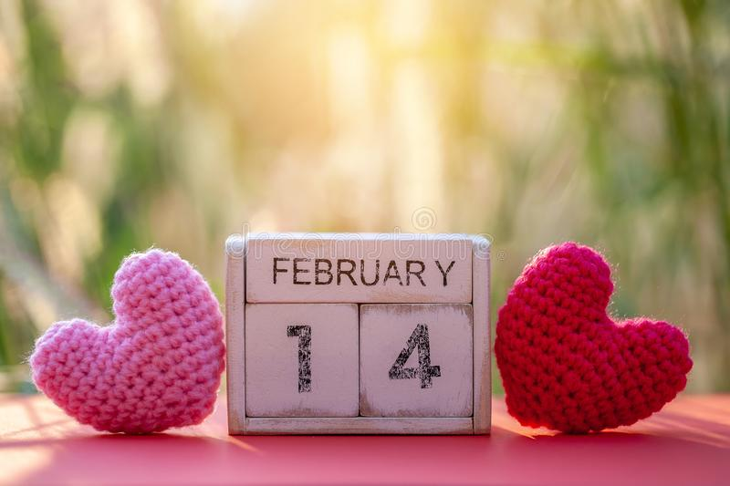 Wooden calendar show of February 14 with pink heart. Valentine`s Day, or St Valentine`s Day, is celebrated every year on 14 royalty free stock photography
