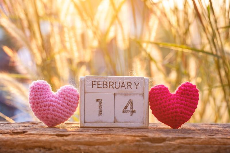 Wooden calendar show of February 14 with pink heart. Valentine`s Day, or St Valentine`s Day, is celebrated every year on 14 stock photo