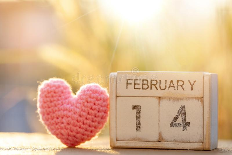 Wooden calendar show of February 14 with pink heart. Valentine`s Day, or St Valentine`s Day, is celebrated every year on 14 royalty free stock photos