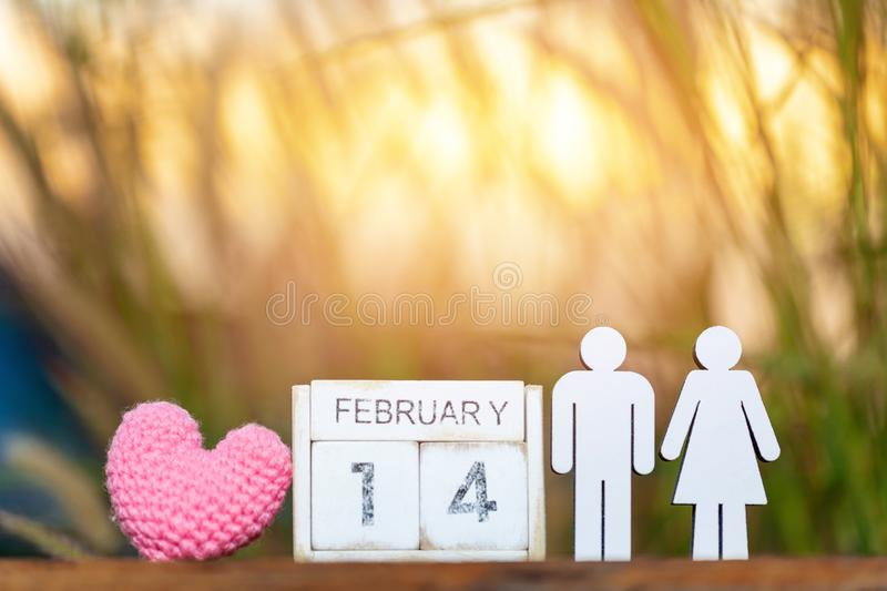Wooden calendar show of February 14 with pink heart. Valentine`s Day, or St Valentine`s Day. Is celebrated every year on 14 February royalty free stock photos