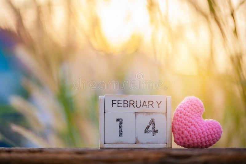 Wooden calendar show of February 14 with pink heart. Valentine`s Day, or St Valentine`s Day stock photography